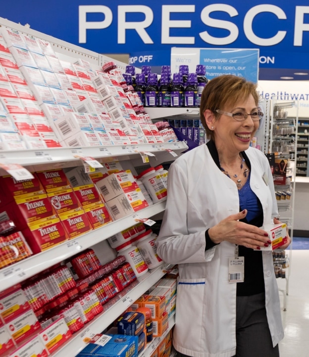 Smiling woman helping customer at the pharmacy.