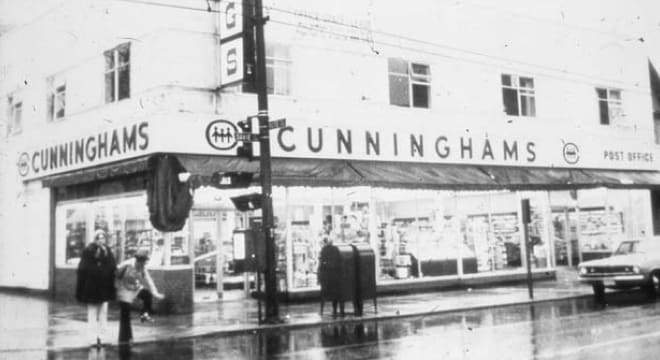 Cunninghams building on corner of a street
