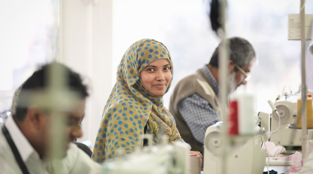 Woman working in sewing factory.