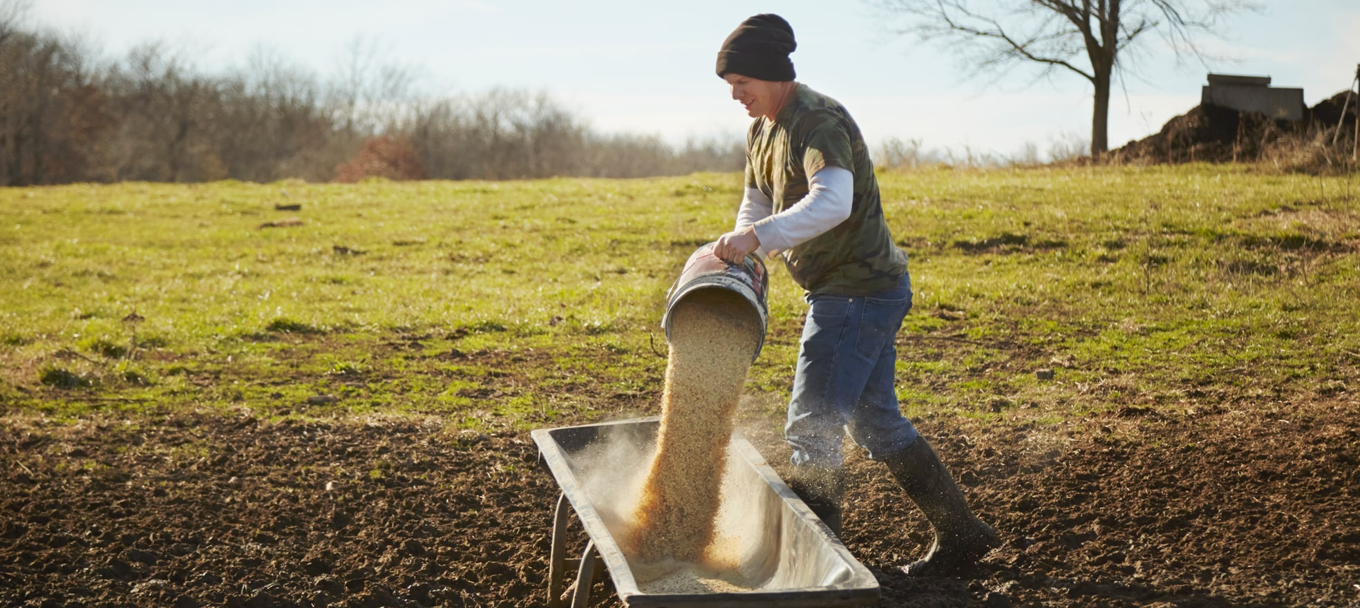 Man with a hat working on a farm.