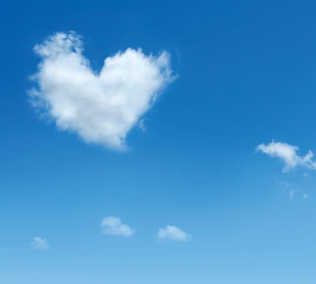 Heart-shaped cloud in a blue sky.