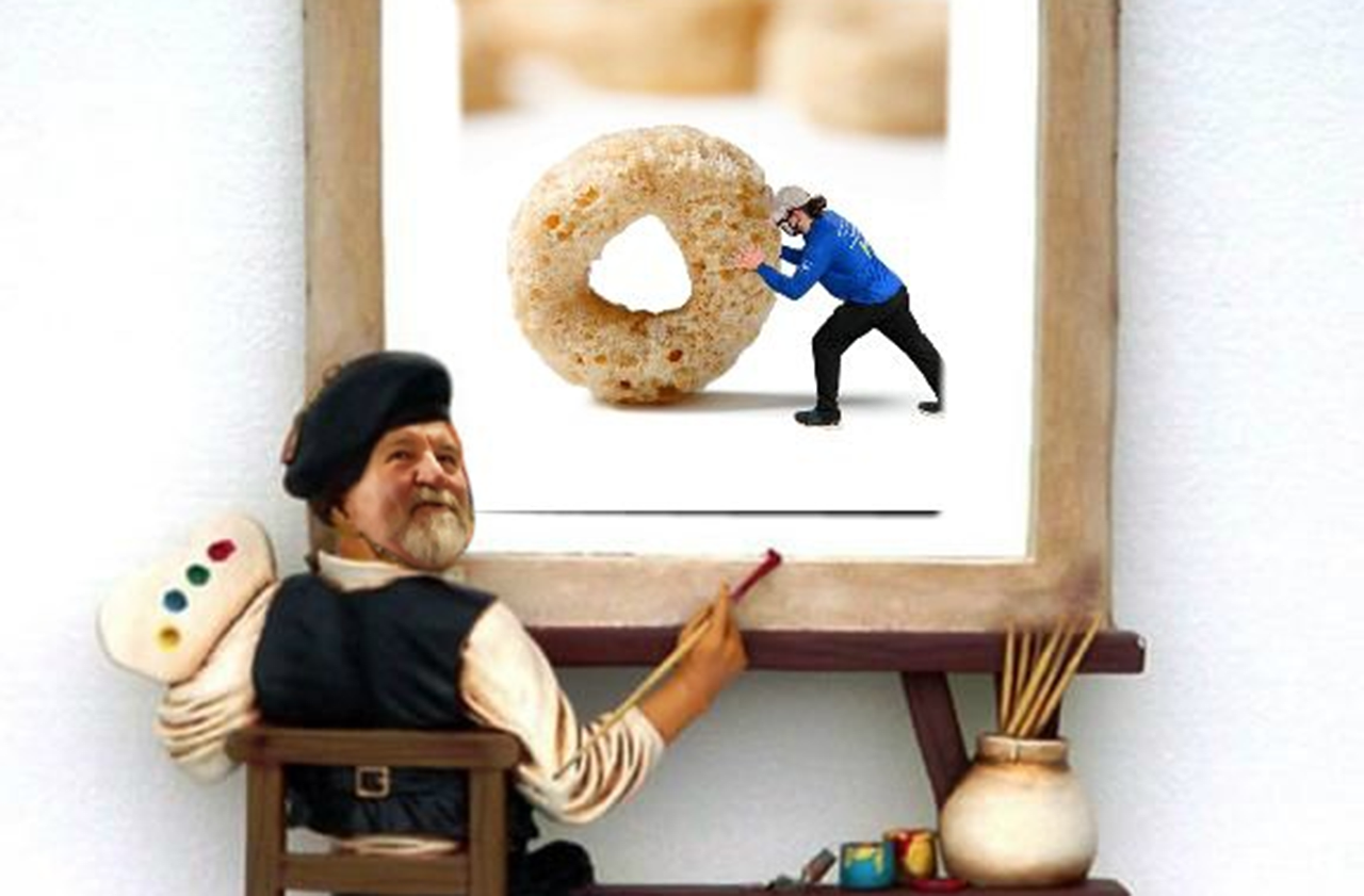 Photoshopped image of a man in a beret holding a paint palette in front of an easel with a photo of a grocery store worker pushing a giant Cheerio on it