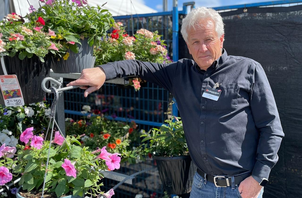 Peter standing in garden centre of grocery store