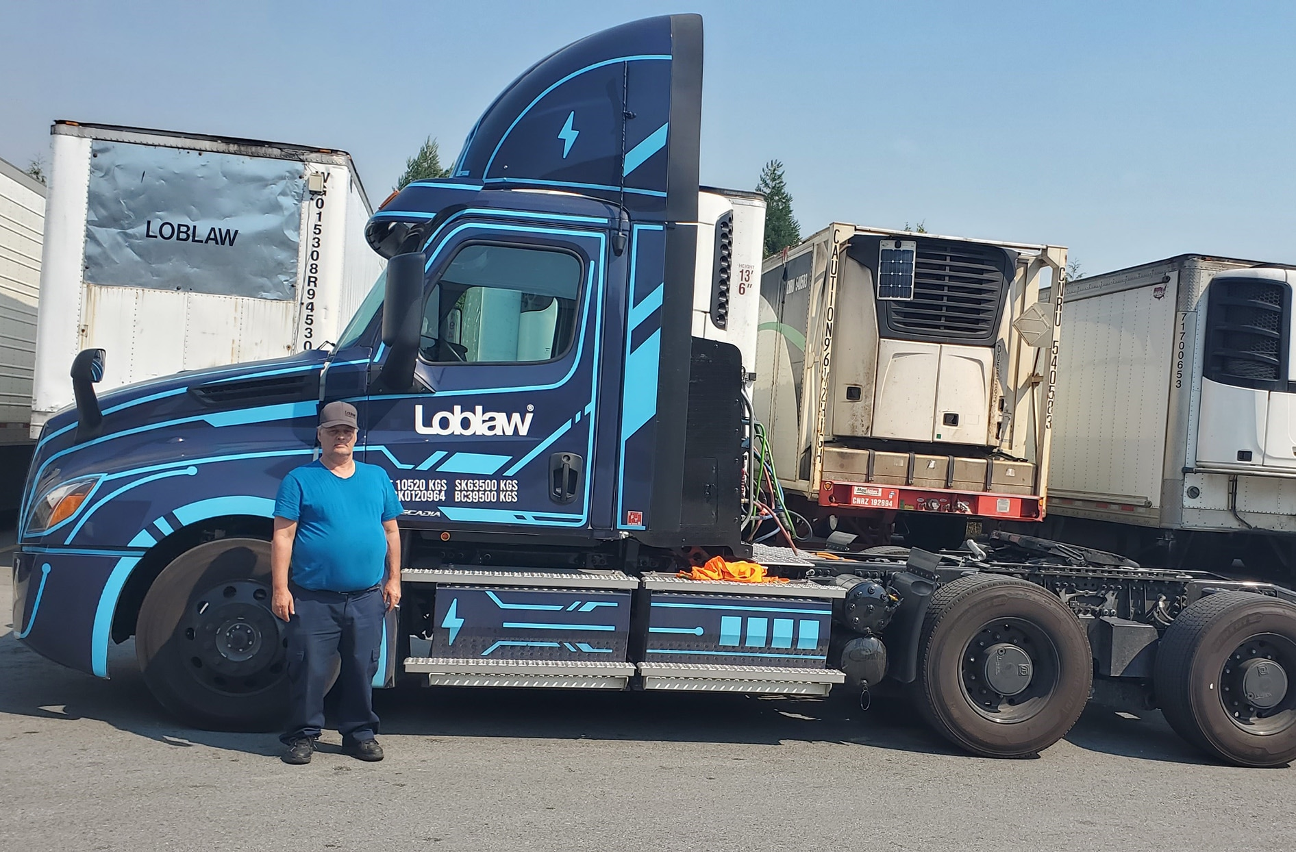 Richard stands in front of the Loblaw Freightliner eCascadia