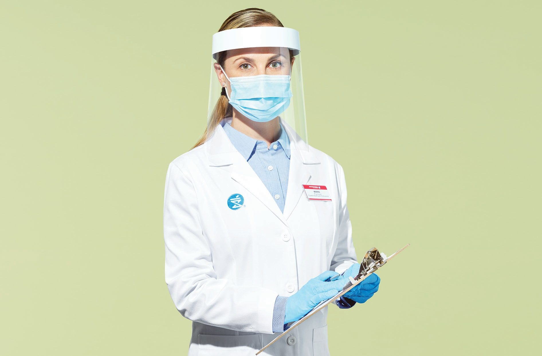 A Shoppers Drug Mart pharmacist wearing a mask, face shield and gloves