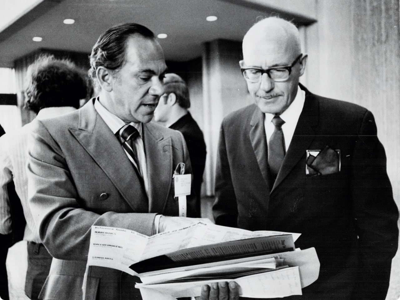 Black and white old photo of 2 men in suits