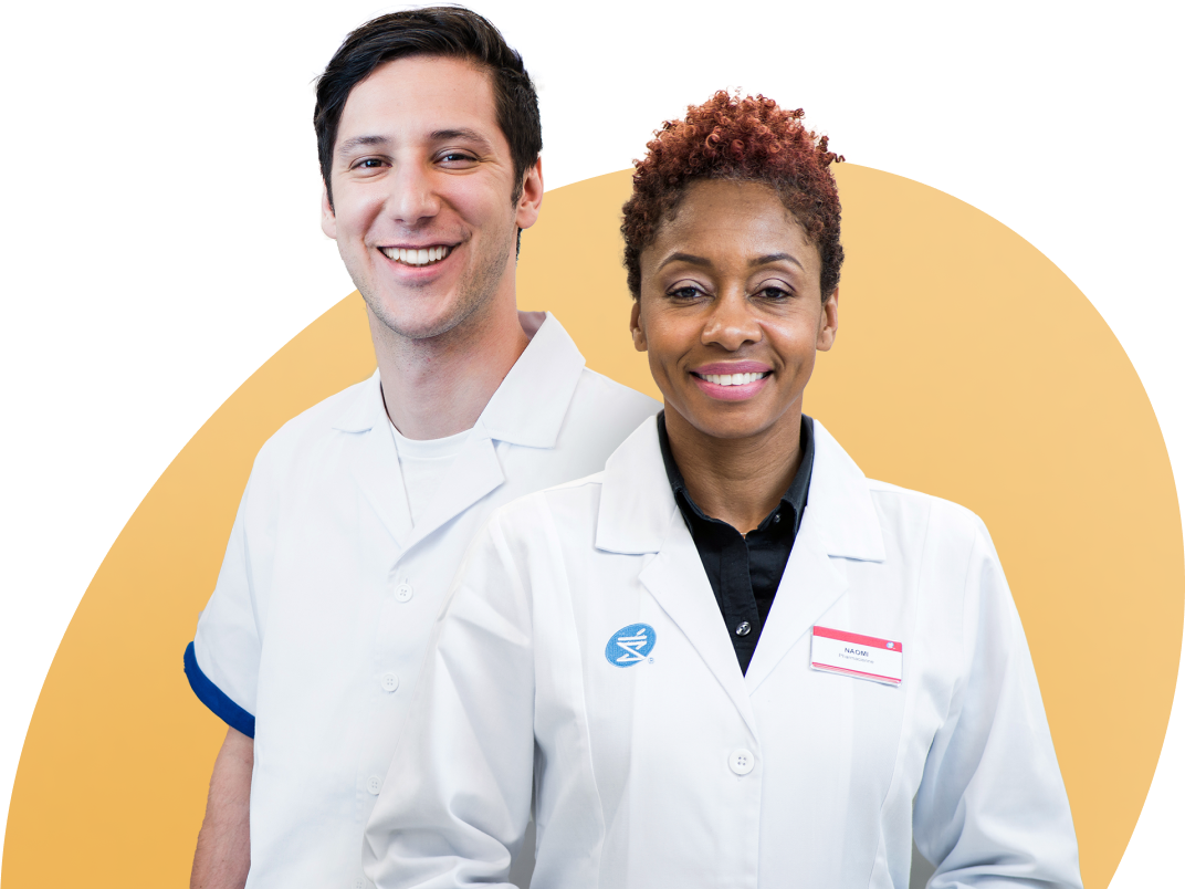 Woman and a man in pharmacy coats smiling